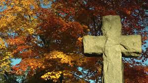cross with fall leaves